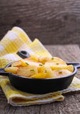 New potatoes fried in a cast iron skillet over Royalty Free Stock Image
