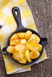 New potatoes fried in a cast iron skillet over Royalty Free Stock Photography
