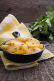 New potatoes fried in a cast iron skillet over Stock Photography