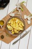 New potatoes and garlic Stock Photos