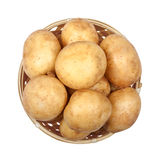 New potatoes in a light basket on an Stock Image