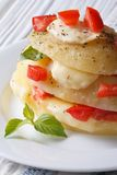 New potatoes with mozzarella, tomato and basil macro vertical Royalty Free Stock Photos