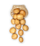 New potatoes in an overturned basket on an Stock Images