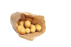 New potatoes in paper bag Stock Images