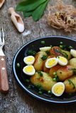 New potatoes with quail eggs Stock Image