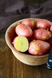New potatoes in a rustic bowl Stock Images