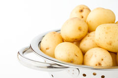 New potatoes in a stainless colander Royalty Free Stock Photography