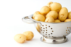 New potatoes in a stainless colander Royalty Free Stock Photos