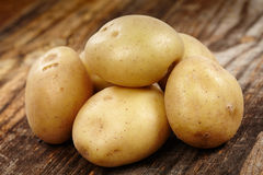 New potatoes on wooden board Royalty Free Stock Images