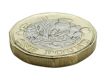 New Pound Coin - front side. New United Kingdom pound coin close up of lettering royalty free stock photos