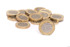 New pound coins. Pile of new pound coins with one stood upright Stock Images