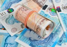 New Pound Notes Roll. Latest edition uk plastic polymer ten and five pound notes Stock Photography