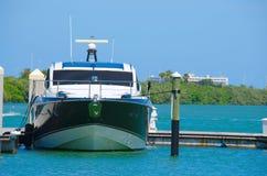 New power boat moored docked at marina dock Royalty Free Stock Photo