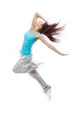 New pretty modern slim hip-hop style dancer teenage girl jumping. Dancing isolated on a white studio background Stock Photo