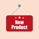 New product sign with shadow hanging on a light background Stock Photo
