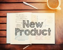 New Product : text inside notebook on table with coffee Royalty Free Stock Images