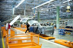 The new production line for the assembly of of cars with modern equipment. Stock Photos