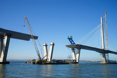 The new Queensferry Crossing Bridge under construction, seen from Port Edgar Edinburgh, Scotland. Showing a mobile crane used for lifting new sections of the stock photo