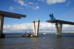 The new Queensferry Crossing Bridge under construction, seen from Port Edgar Edinburgh, Scotland. Showing a mobile crane used for lifting new sections of the royalty free stock photo