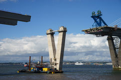 The new Queensferry Crossing Bridge under Construction, seen from Port Edgar Edinburgh, Scotland. Showing a mobile crane used for lifting new sections of the royalty free stock photos