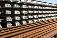 New rails and sleepers. The rails and sleepers are stacked on each other. Renovation of the railway. Rail road for the train Royalty Free Stock Photo