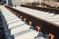 New rails and sleepers. The rails and sleepers are stacked on each other. Renovation of the railway. Rail road for the train Royalty Free Stock Image