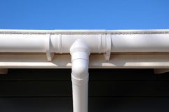 New rain gutter on a home against blue sky. Royalty Free Stock Photography
