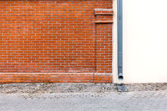 New rain water downspout against. Red brick wall of house with new metal downspout stock images