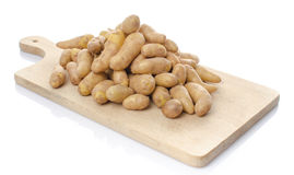 New rattes potatoes on a wooden board Stock Photos