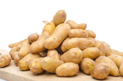 New rattes potatoes on a wooden board Stock Image