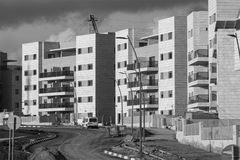 Black and white image of New ready residential neighborhood. New ready residential neighborhood - last development steps before populating. Black and white image Stock Photos