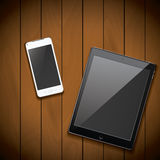 New realistic mobile phone smartphone and tablet mockup template on wood background.  Stock Photo