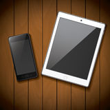 New realistic mobile phone smartphone and tablet mockup template on wood background.  Stock Images