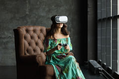 New reality is here Handsome young woman in VR headset, The VR headset design is generic and no logos, Woman with glasses of virtu Royalty Free Stock Image