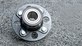 New rear wheels car bearing  on asphalt floor in garage and copy Stock Image
