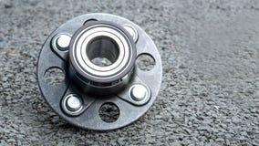 New rear wheels car bearing  on asphalt floor in garage and copy Stock Image