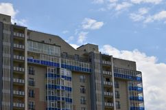 New or recently completed multi-storey residential building with windows and balconies. Russian type of house buildin. G Royalty Free Stock Photo