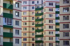 New or recently completed multi-storey residential building with windows and balconies. Russian type of house buildin. G Royalty Free Stock Photos