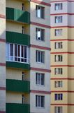 New or recently completed multi-storey residential building with windows and balconies. Russian type of house buildin. G Stock Photo