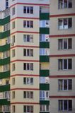 New or recently completed multi-storey residential building with windows and balconies. Russian type of house buildin. G Stock Photos