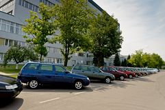 The new, recently descended from the conveyor cars standing in a row. royalty free stock images