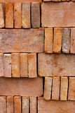 New red brick pavers stacked in rows like wall. Store of bricks Stock Image