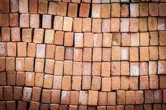 Wall of new red bricks stacked in rows. Royalty Free Stock Photography
