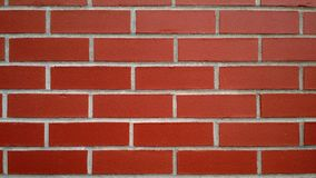 New red brick wall for background or texture. Closeup of new red brick wall for web graphics, background, texture or wallpaper Stock Images