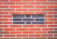 New red brick wall with a stuffy window. Background Stock Images