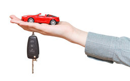 New red car with key on hand isolated Stock Photo
