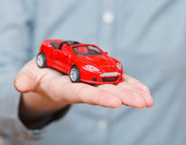 New red car on palm Royalty Free Stock Images