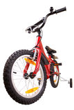 New red children's bicycle on white Royalty Free Stock Images