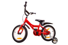New red children's bicycle on white Royalty Free Stock Photography