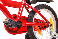 New red children's bicycle on white Royalty Free Stock Image